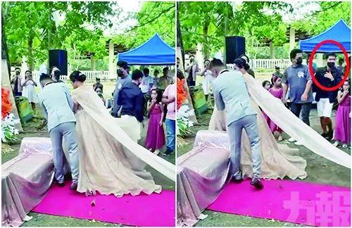 新娘裙底鑽出神秘男