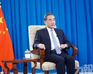 王毅訪日料與首相及外相會面